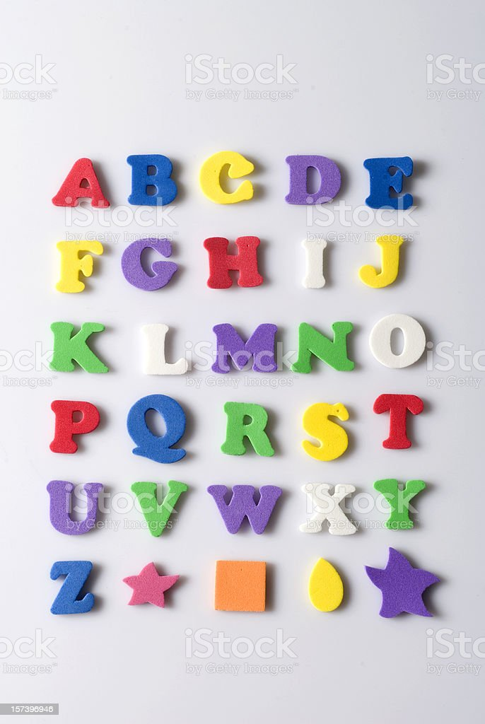 Rubber letters and shapes on white background stock photo