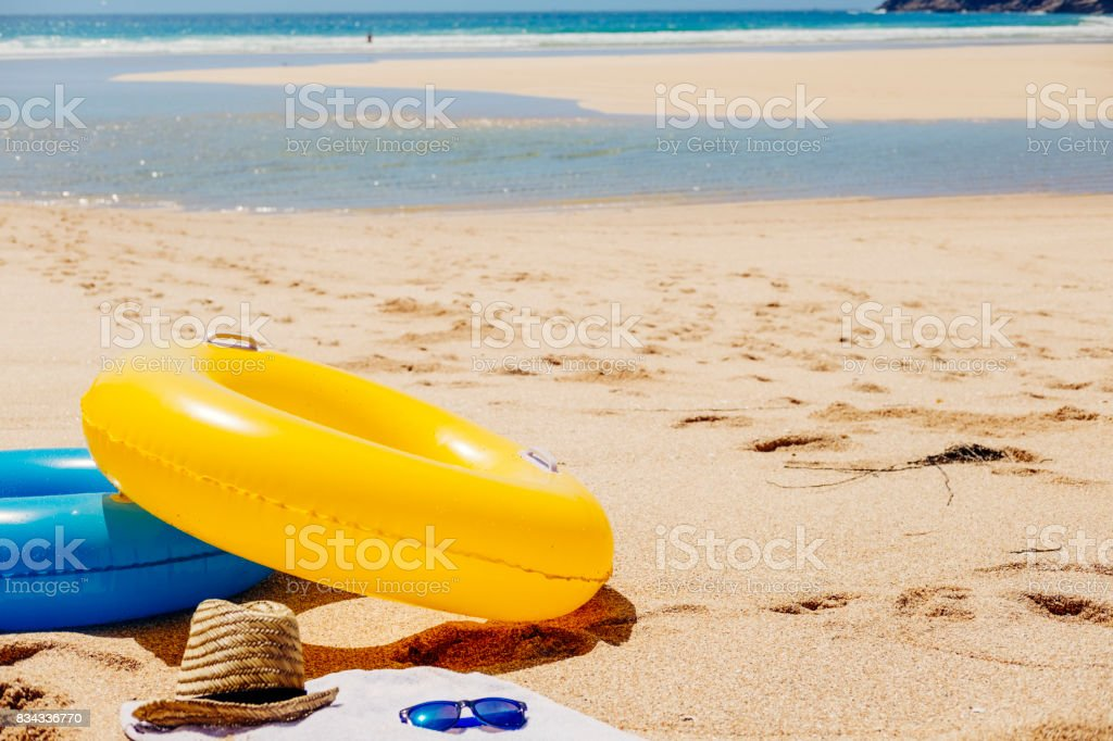 Rubber rings on Pedn Vounder Beach, South Cornwall. stock photo