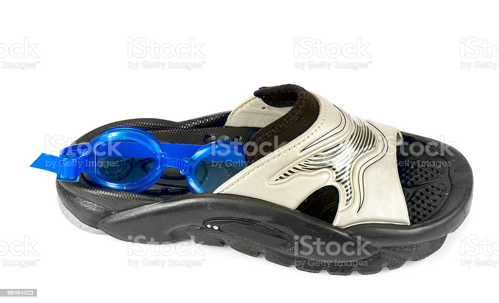 Rubber slippers and goggles for swimming royalty-free stock photo