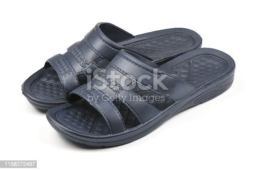istock Rubber slippers. Pair of blue flip flops isolated on a white. 1158272457
