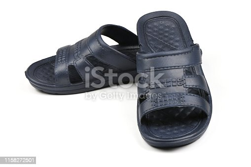 istock Rubber slippers. Pair of blue flip flops isolated on a white. 1158272501