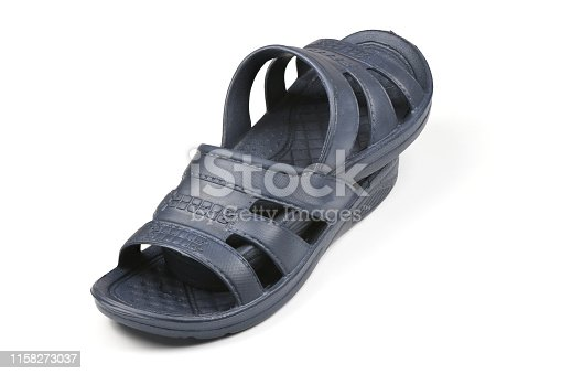 istock Rubber slippers. Pair of blue flip flops isolated on a white. 1158273037