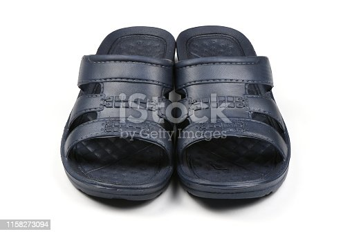 istock Rubber slippers. Pair of blue flip flops isolated on a white. 1158273094