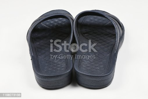 istock Rubber slippers. Pair of blue flip flops isolated on a white. 1158273133