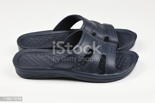 istock Rubber slippers. Pair of blue flip flops isolated on a white. 1158273239