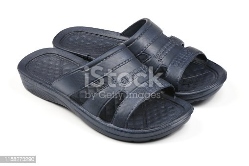 istock Rubber slippers. Pair of blue flip flops isolated on a white. 1158273290