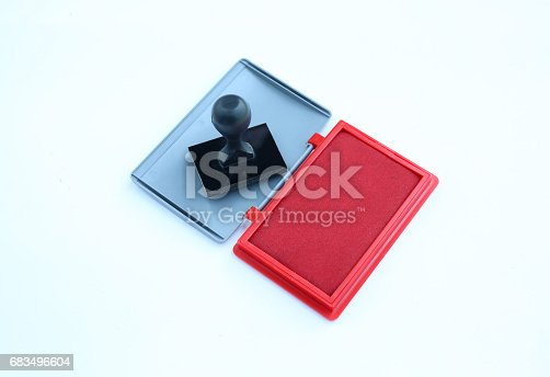 683496662 istock photo Rubber stamp and Red Ink cartridges on white background. 683496604