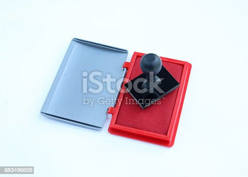 istock Rubber stamp and Red Ink cartridges on white background. 683496638