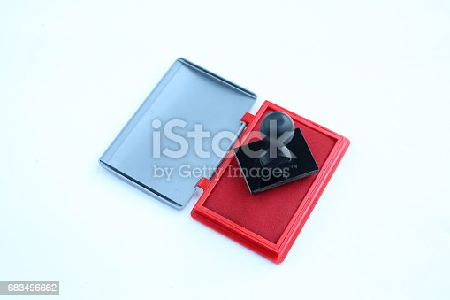 683496662 istock photo Rubber stamp and Red Ink cartridges on white background. 683496662