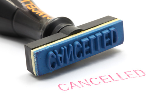 closeup of cancelled letter on rubber stamp isolated on white background