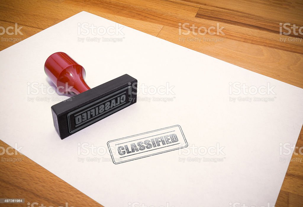 Rubber Stamp: CLASSIFIED stock photo