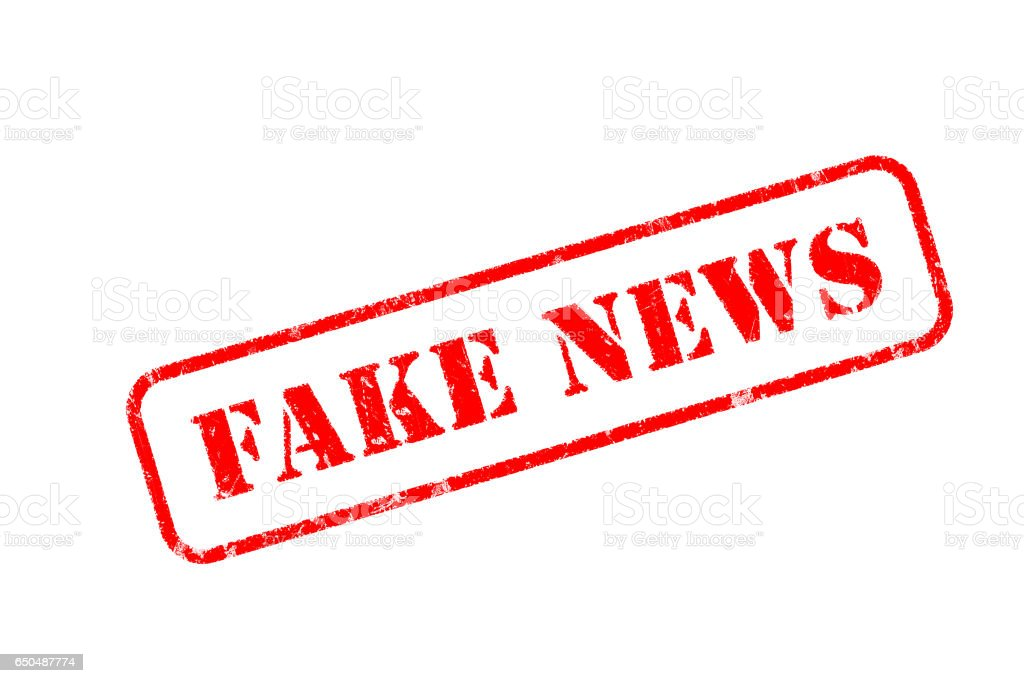 FAKE NEWS  rubber stamp over a white background stock photo