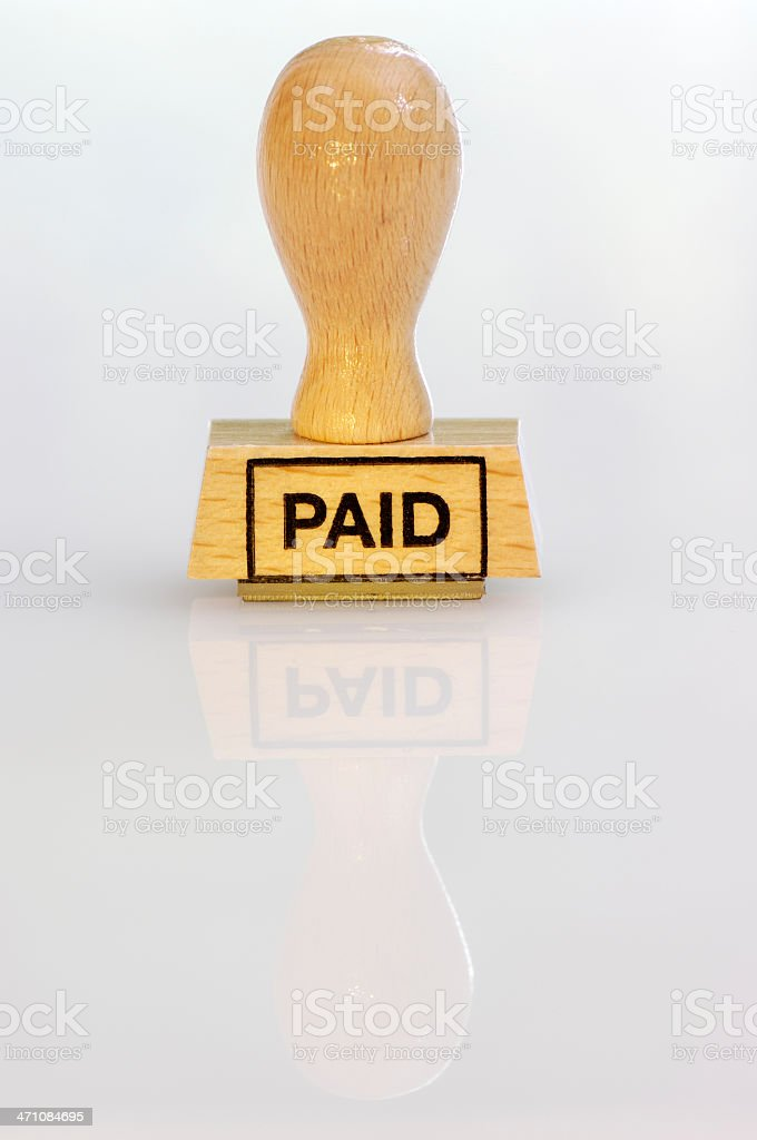 Rubber stamp paid royalty-free stock photo