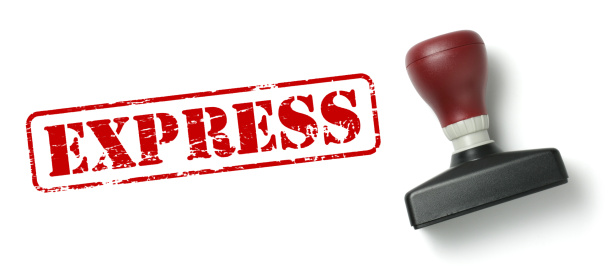 Top view of a rubber stamp with a giant word