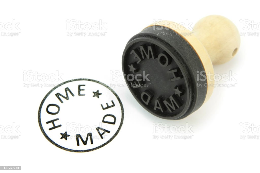 Rubber stamp with ' HOME MADE ' text stock photo