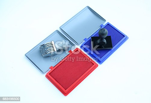 683496662 istock photo Rubber stamper and Red - Blue Ink cartridges on white background. 683496500