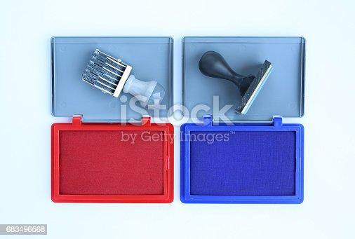 683496662 istock photo Rubber stamper and Red - Blue Ink cartridges on white background. 683496568