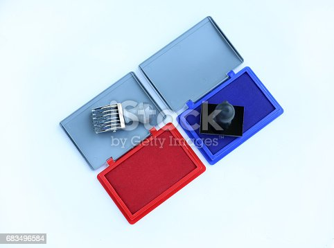istock Rubber stamper and Red - Blue Ink cartridges on white background. 683496584