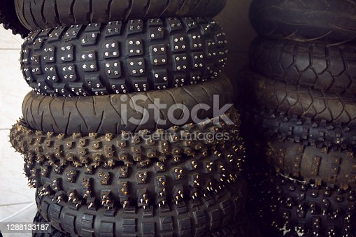 rubber studded wheels with deep tread from the motorcycle are stored in the box