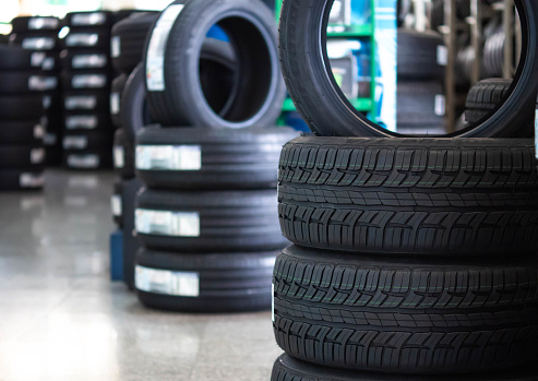 close up rubber tire and wheels at garage business shop object background
