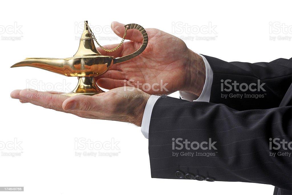 Rubbing Aladdins Lamp royalty-free stock photo