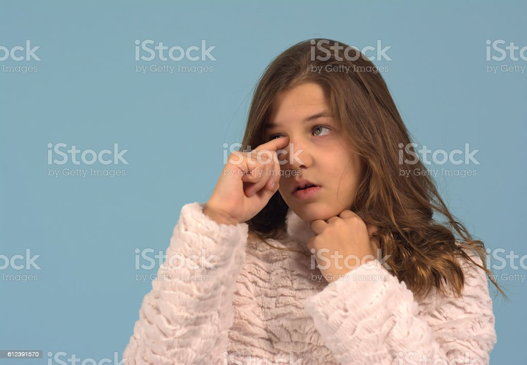 Rubbing an eye stock photo