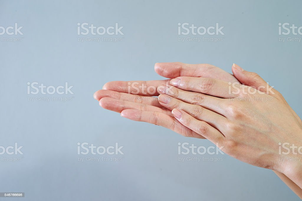 Rubbing hands stock photo