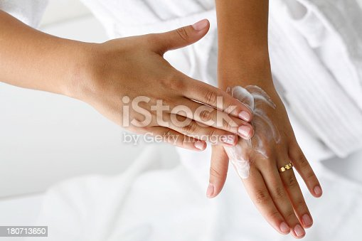Appliying moisturizer in female hands