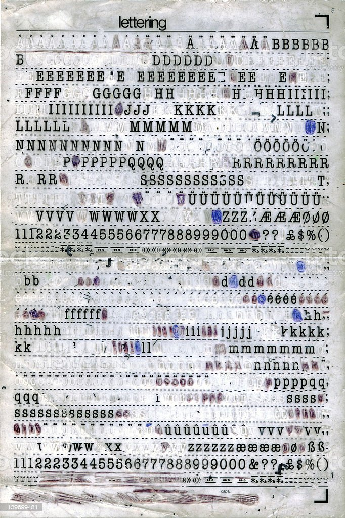 Rubbing Out the letters - Letraset shee stock photo