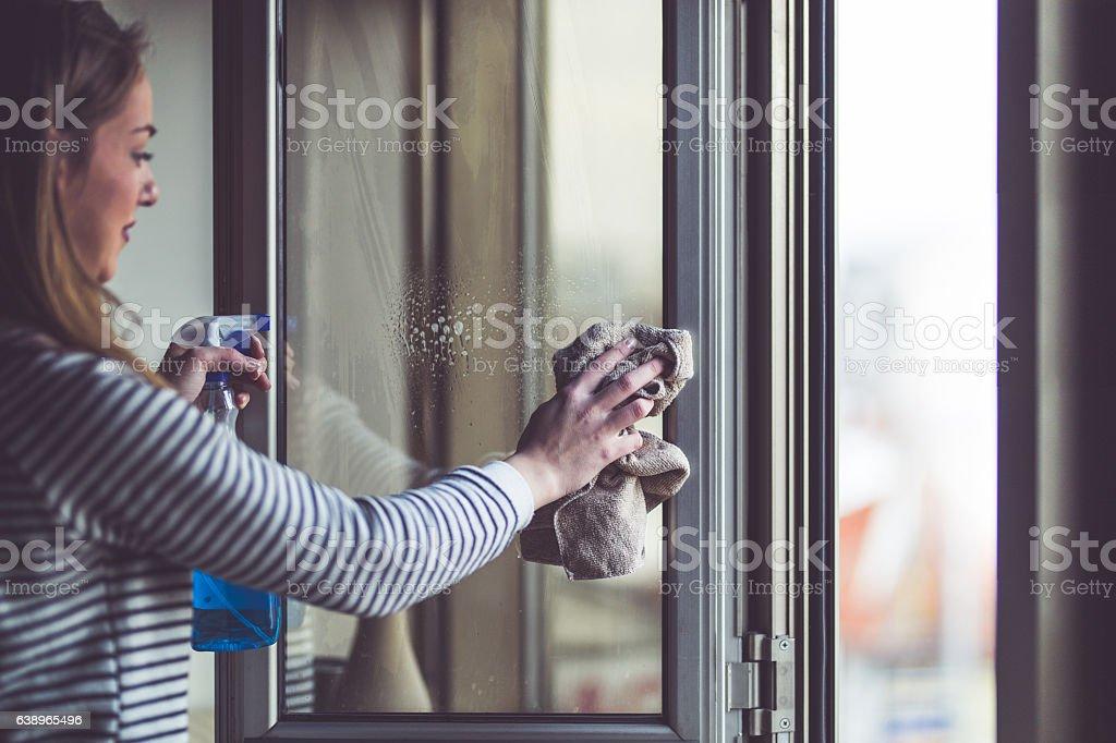 Rubbing the window stock photo