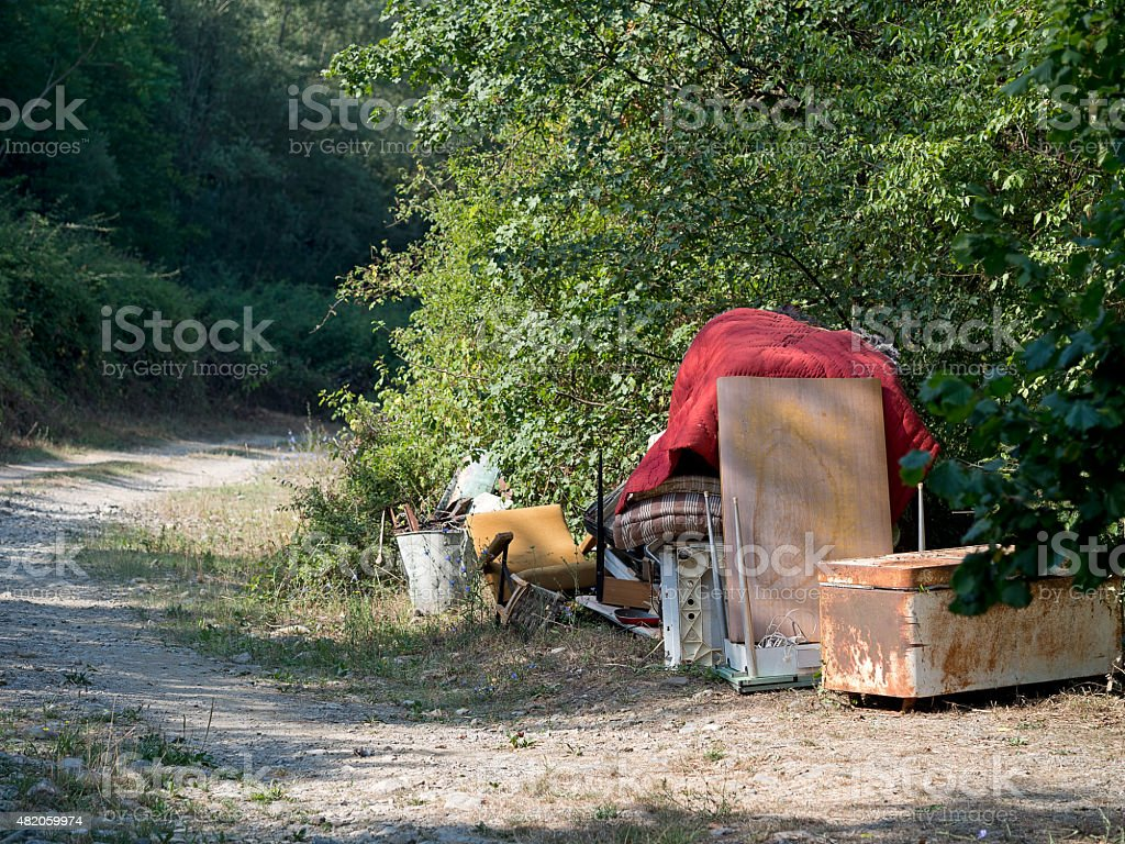 Rubbish by roadside, fly tipping, environmental pollution stock photo