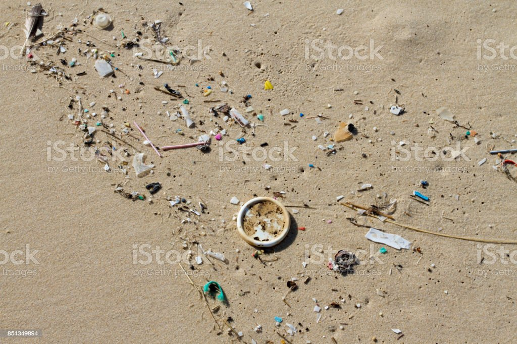Rubbish washed up on the beach stock photo
