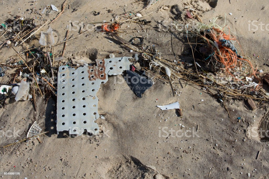 Rubbish washed up on the shore on the beach background stock photo