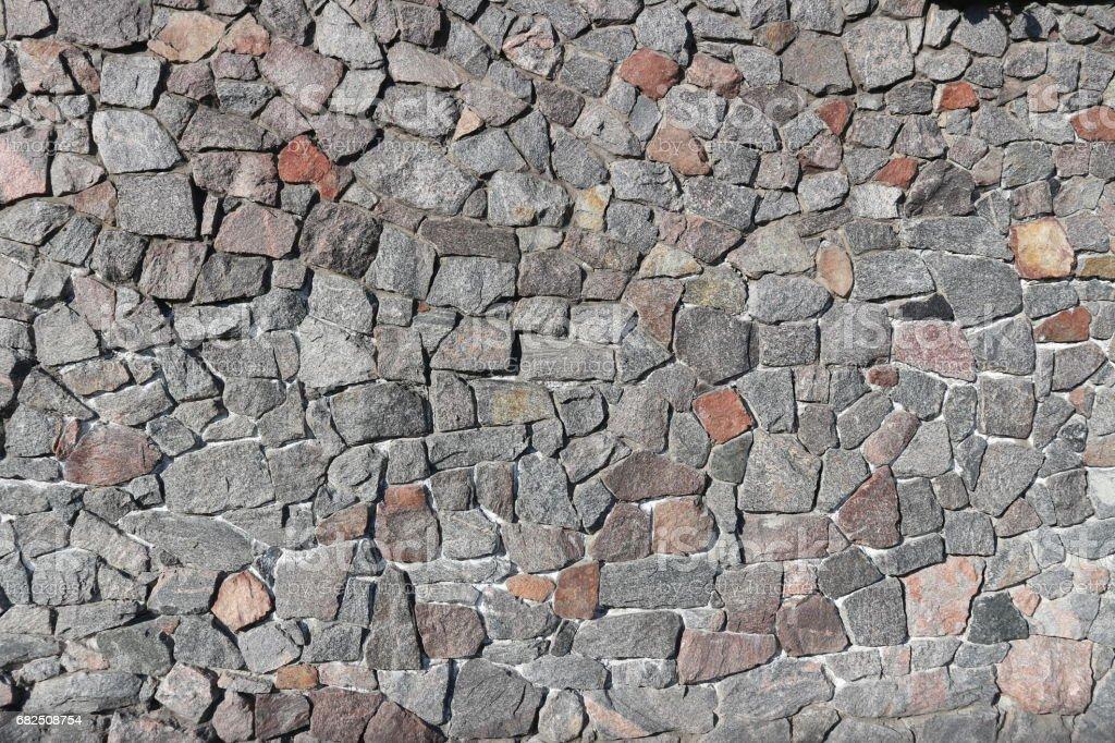 Moloz gri ve kahverengi taş duvar, rubblework. royalty-free stock photo
