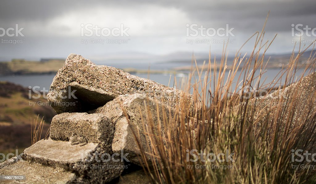 Rubble of a crumbling cottage with storm approaching stock photo