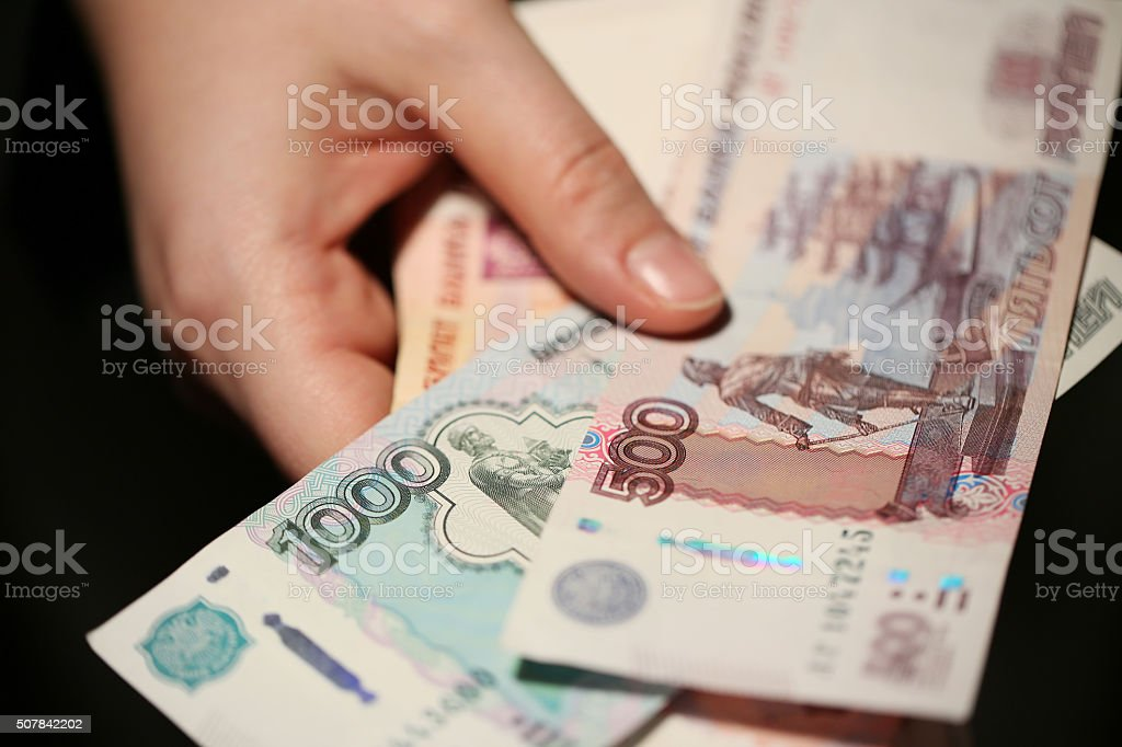 Rubles in hands. stock photo