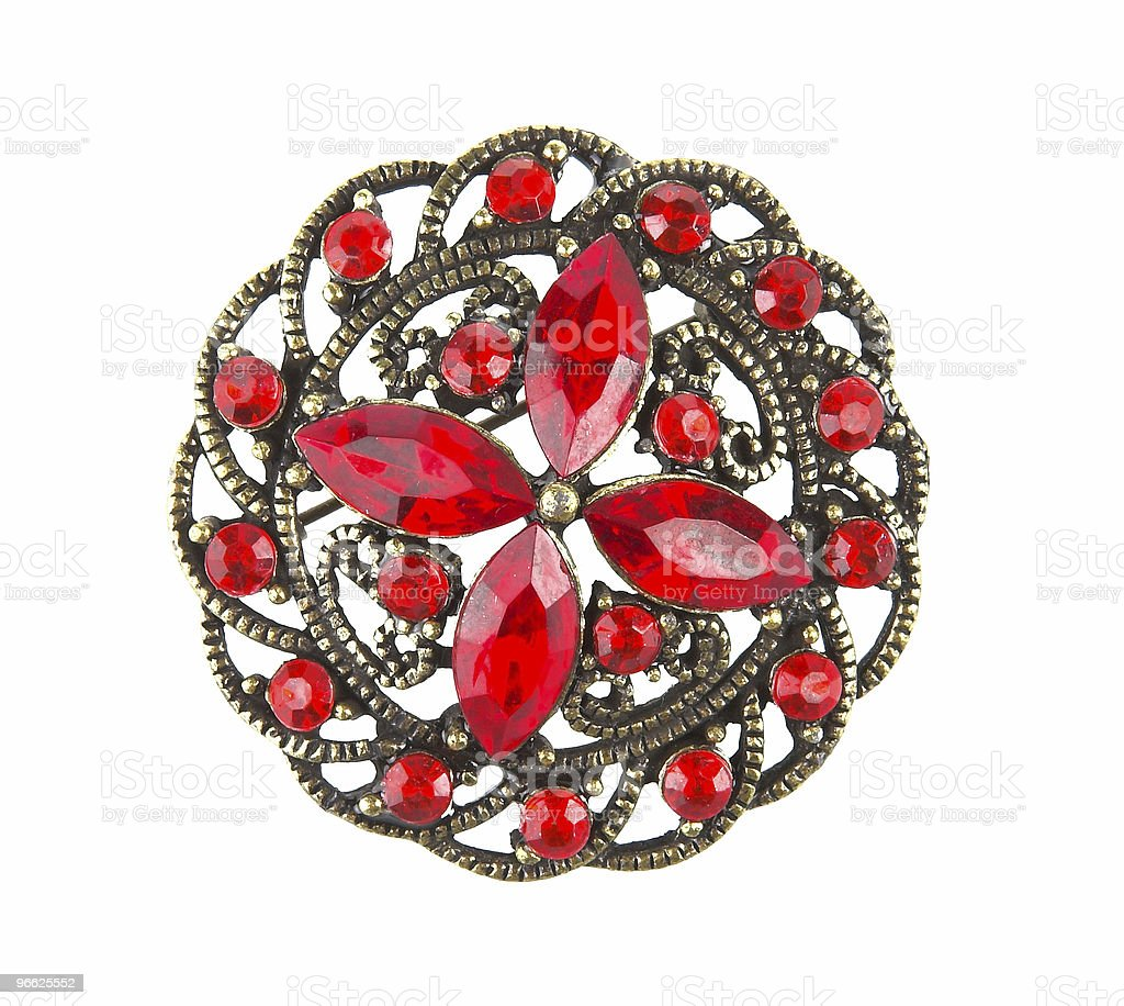 A ruby and gold floral brooch isolated on white royalty-free stock photo