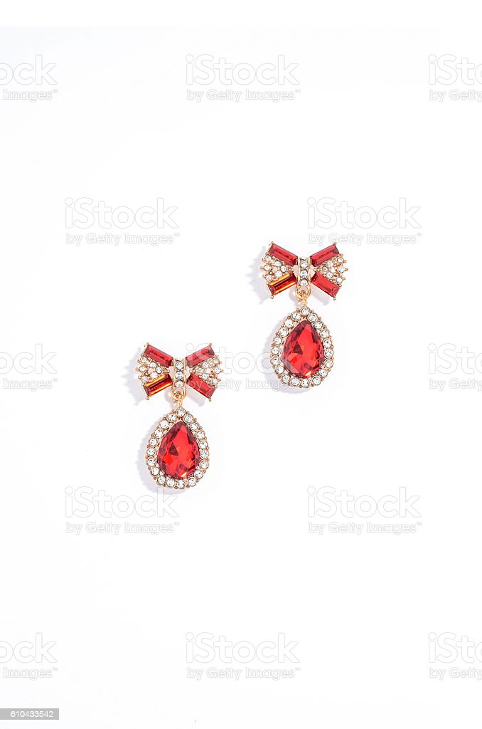 ruby earrings on a white background stock photo