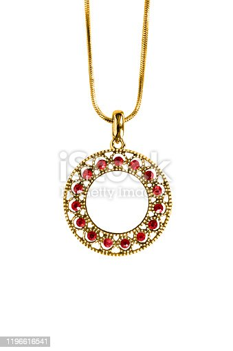 Precious ruby pendant hanging on gold chain on white background