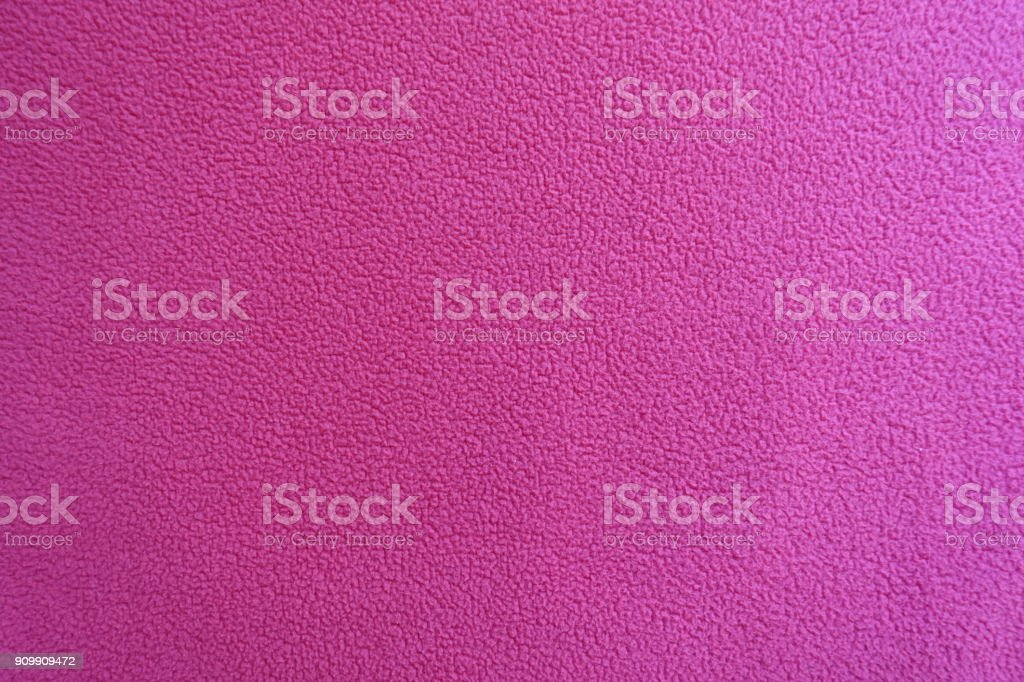 Ruby red polar fleece fabric from above stock photo