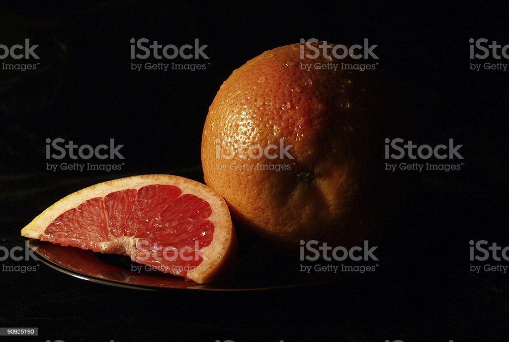 Rubyred grapefruit on black background stock photo