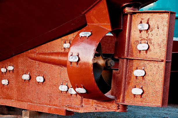 Rudder and propeller of a fish trawler Rudder and propeller of a fish trawler after maintenance anode stock pictures, royalty-free photos & images