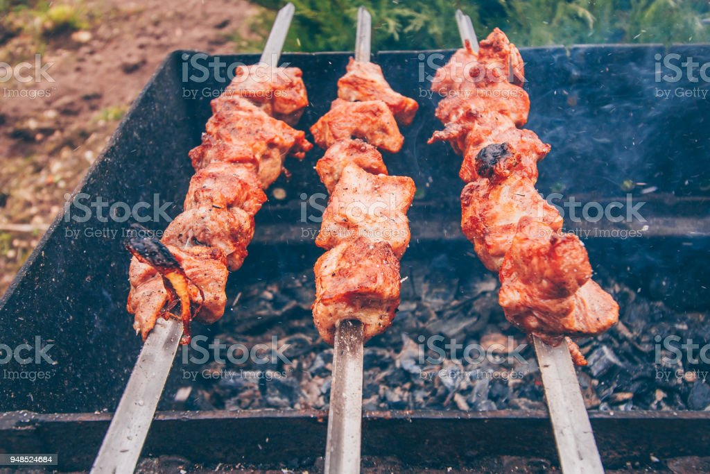 Ruddy juicy hot kebab over an open fire stock photo