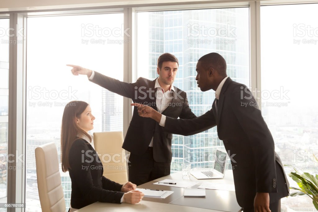 Rude black businessman getting fired for inappropriate behavior, bad manners stock photo