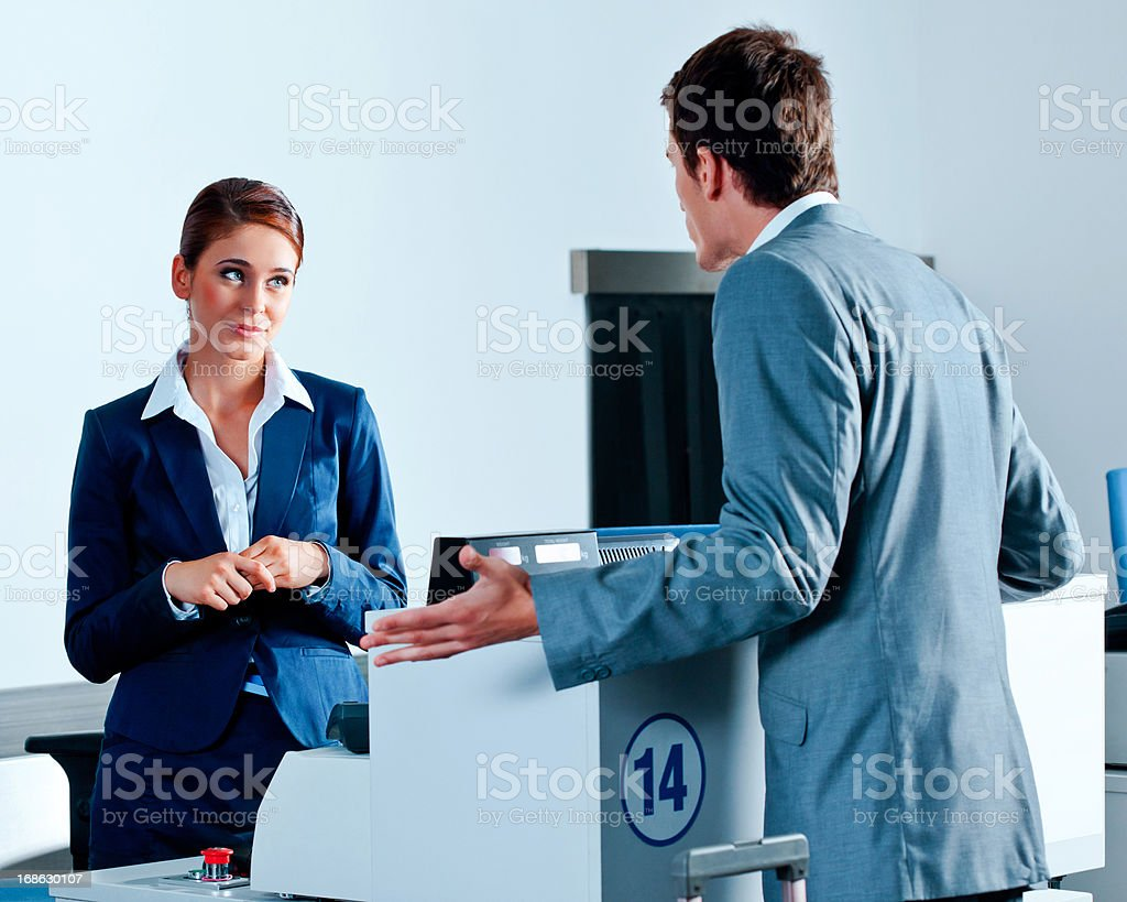 Rude businessman at the airport check-in stock photo
