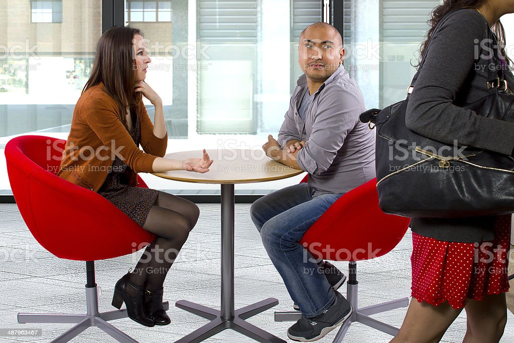 Rude Date or Incompatible Interracial Couple at a Cafe stock photo