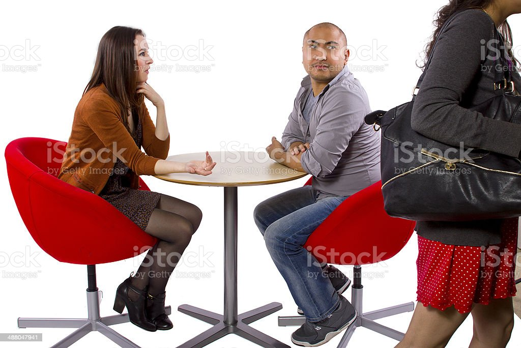 Rude Date or Incompatible Interracial Couple on a White Background stock photo