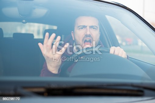 istock Rude man driving his car and arguing a lot 660298170