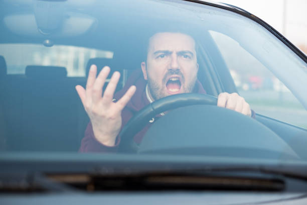 rude man driving his car and arguing a lot - aggression stock pictures, royalty-free photos & images
