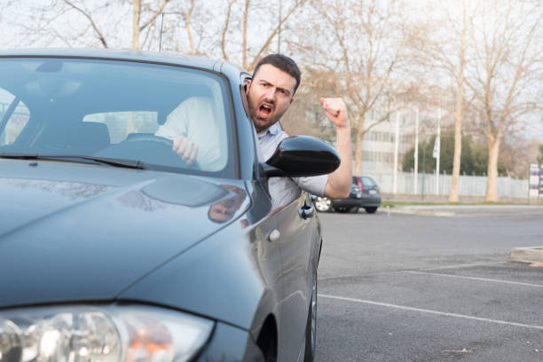 rude man driving his car and arguing - row of heads stock photos and pictures